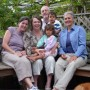 Adoptive parents Jane and Amy (far left and far right) with foster parents Louise and Ian (middle) and the twins. Courtesy Watershed Productions.